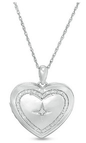 1/10 CT. T.W. Diamond Heart Outline with Star Locket in Sterling Silver
